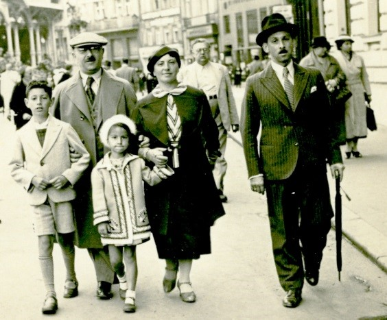 1938—Our family with Uncle Benno behind Henry and me.  Photo taken by a street photographer in Karlsbad