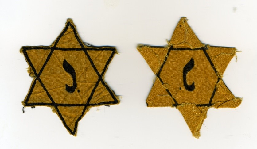 1942 - This Yellow Star (Magen David) was worn by one of my parents. The picture shows front and back with still some hanging threads