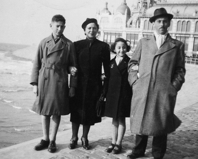 1939 – Henry, my mother, I and my father standing on the Boardwalk with the old casino in the background.