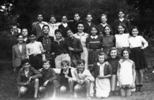 The combination class of 6th, 7th, and 8th grades. I am standing next to Mademoiselle Michelet, our teacher