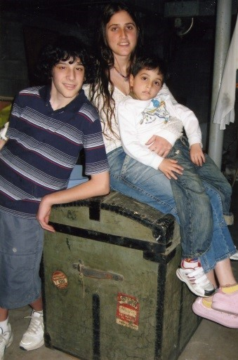 1998 – Joshua, Ginat & Marshall sitting on our trunk still stored in the Hellers Sr. basement in NJ